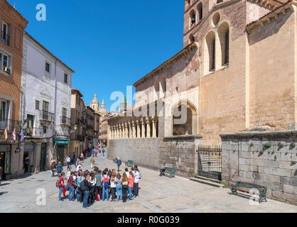 Group of school students in the Plaza de San Martin outside the 12th century church of San Martin, Segovia, Castilla y Leon, Spain - Stock Photo
