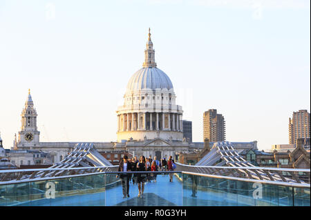St Pauls Cathedral and the Millennium Bridge on a bright spring day, in central London in the UK - Stock Photo