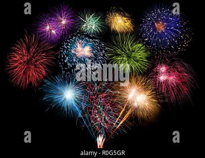 colorful fireworks display and bright sparkler pyrotechnic happy new year sylvester concept on black blue background - Stock Photo