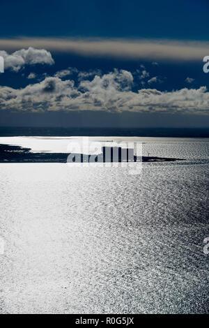 Heysham Power Station silhouetted, at Morecambe Bay, North West England, UK - Stock Photo