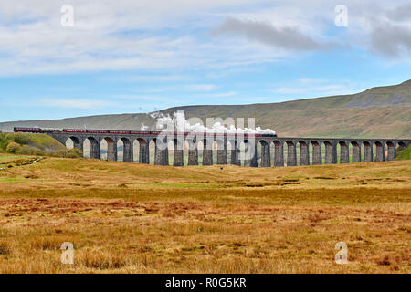 Preserved steam hauled train at Ribblehead Viaduct on the Settle & Carlisle Railway line, Yorkshire Dales National Park, Northern England, UK