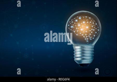 brain light bulb human brain glowing inside of light bulb on dark blue background - Stock Photo