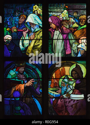 Detail of the stained-glass window designed by Czech Art Nouveau artist Alfons Mucha in Saint Vitus' Cathedral in the Prague Castle in Prague, Czech Republic. The scenes from the life of Saints Cyril and Methodius are depicted in the stained-glass window from top to bottom: Saints Cyril and Methodius transfer the relics of Saint Pope Clement I from Crimea to Rome; Saints Cyril and Methodius present to Pope Adrian II the translation of the liturgical books into Slavonic language. - Stock Photo