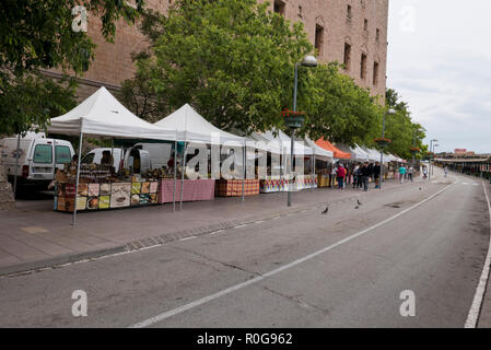 A row of stalls selling local produce outside the Montserrat Monastery walls, Montserrat, Barcelona, Spain - Stock Photo