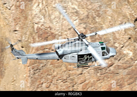 Bell UH-1Y Venom flown by US. Marines helicopter squadron HMLA-369 'Gunfighters' flying through Star Wars Canyon in 2018 - Stock Photo