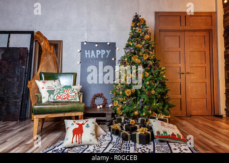 Classic christmas New Year decorated interior room New year tree. Christmas tree with gold decorations. Modern dark classical style interior design apartment. Christmas eve at home - Stock Photo