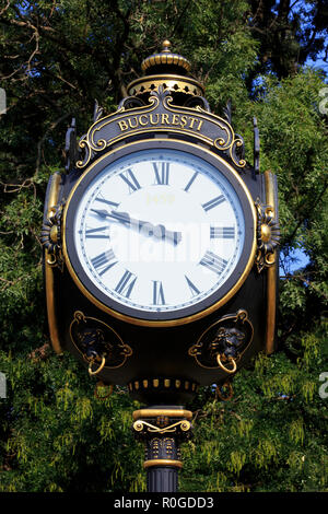 Close-up of the vintage 19th-century street clock at the corner of the Cismigiu Gardens and the Triumphal Arch in Bucharest, Romania - Stock Photo