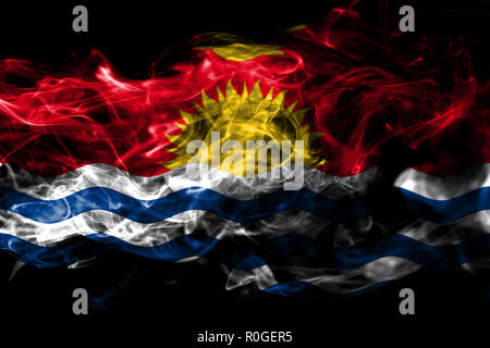 National flag of Kiribati made from colored smoke isolated on black background. Abstract silky wave background - Stock Photo