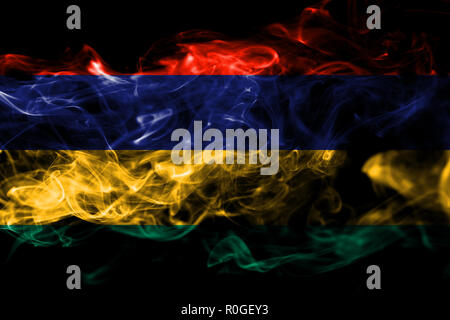 National flag of Mauritius made from colored smoke isolated on black background. Abstract silky wave background - Stock Photo