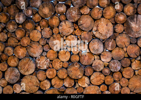 Wooden photo zone with a background of wooden circles. Festive photo area on the street with furniture, free space. - Stock Photo