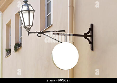 Signboard on the wall. Mock up. Round shape - Stock Photo