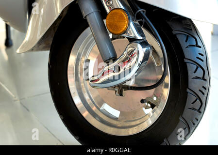 Close up front wheel of modern motorbike - Stock Photo