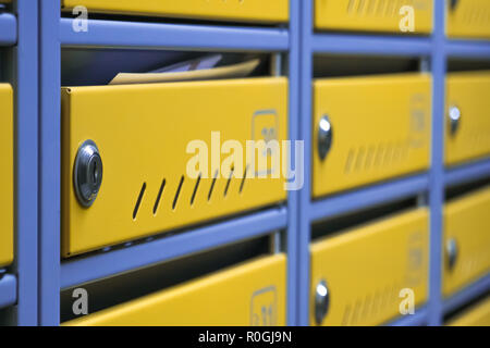 metal mailboxes in an apartment building. Cool mailboxes - Stock Photo