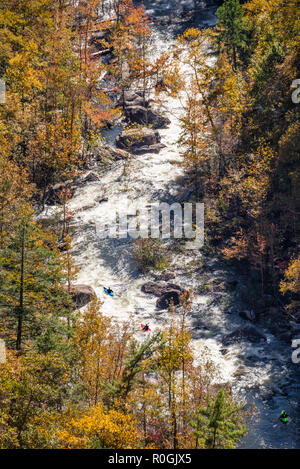 Three whitewater kayakers on the Tallulah River in Northeast Georgia's Tallulah Gorge State Park. (USA) - Stock Photo