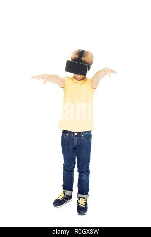 full length view of cute little boy using virtual reality headset isolated on white - Stock Photo