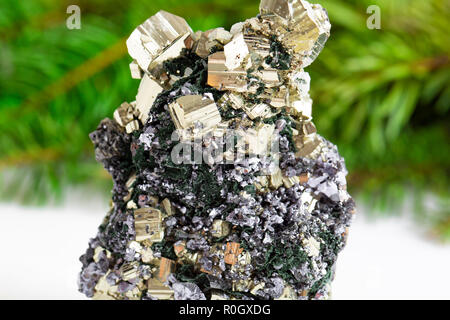Macro shooting of natural gemstone. The raw mineral is pyrite, China. Isolated object on a white background. - Stock Photo