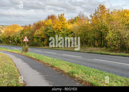 Two way traffic ahead road sign on a UK road - Stock Photo