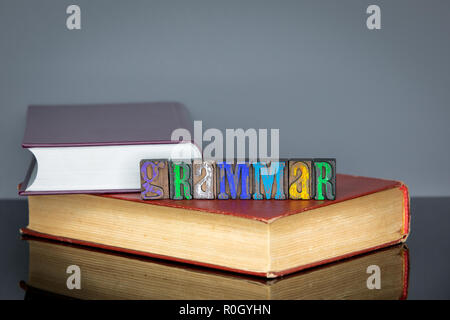 Grammar word from colored wooden letters on gray background - Stock Photo