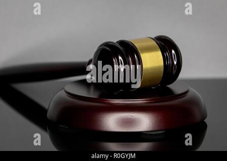 Judge's gavel on gray background