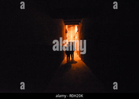 Silhouettes of a European Couple walking at night in Marrakech Medina Morocco North Africa - Stock Photo