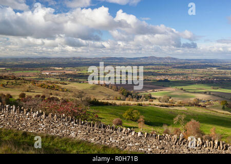 View from the summit of Bredon Hill looking west to the distant Malvern Hills in autumn morning sunshine, Kemerton, Worcestershire, England, UK - Stock Photo