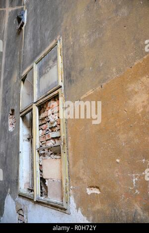 bricked window in the old town of Karlovy Vary in the Czech Republic - Stock Photo