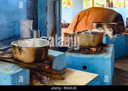 Farm rustic kitchen in the interior of Brazil with wood stove and oven of clay preparing the food to be served - Stock Photo