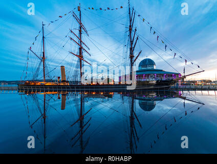 Reflection  of RRS Discovery ship at Discovery Point museum in the evening in Dundee, Tayside, Scotland, UK - Stock Photo