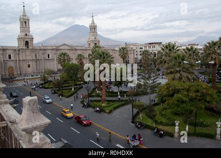Church and palm trees on Plaza de Armas in Arequipa, Peru, South America - Stock Photo