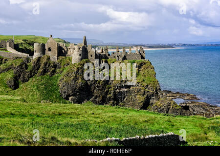 Dunluce Castle is a now-ruined medieval castle in Northern Ireland - Stock Photo