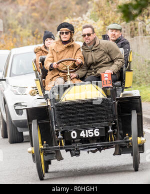 "Pyecombe, East Sussex, UK. 4th November 2018. Yasmin Le Bon seen here driving takes part in the 79th  ""Bonham's"" London to Brighton Veteran car run. The 60 mile route, starting in Hyde Park London concludes at Madeira Drive Brighton. The vehicles in this year annual event, including an 1895 Peugeot and an 1898 Panhard et Levassor were all built between 1893 and 1905. Credit: Newspics UK South/Alamy Live News - Stock Photo"