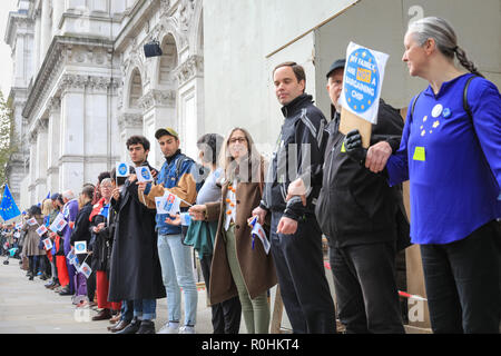 Westminster, London, UK, 5th Nov 2018. Protesters form a human chain from Downing Street to Parliament Square in Westminster. ;The Last Mile' mass lobby in Westminster is organised by anti-Brexit organisation The Three Million and others, highlighting that no withdrawal agreement has been published yet regarding EU citizens in the UK. Credit: Imageplotter News and Sports/Alamy Live News - Stock Photo