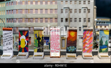 Berlin, Germany. 05th Nov, 2018. Wall elements designed by celebrities on a scale of 1:21 will be shown in the exhibition at a press event on the anniversary of the fall of the Berlin Wall 28 years ago in Little Big City Berlin. The mini wall pieces can be bought at auction and the proceeds go to the organisation 'Merlin's Magic Wand', which supports needy children. Credit: Jens Kalaene/dpa-Zentralbild/ZB/dpa/Alamy Live News - Stock Photo
