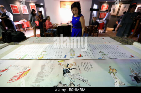 Los Angeles, USA. 4th Nov, 2018. A woman visits an exhibition of traditional Chinese handicrafts in Los Angeles, the United States, on Nov. 4, 2018. The exhibition, which runs until Nov. 9, displays works of Chinese paper cutting, clay figurine, silk painting and calligraphy at the Sino-Asian Art Gallery in El Monte, Los Angeles. Credit: Li Ying/Xinhua/Alamy Live News - Stock Photo