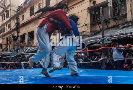 (181105) -- KOLKATA(INDIA), Nov. 5, 2018 (Xinhua) -- Female wrestlers compete during a street competition to popularize the sport in Kolkata, India on Nov. 5, 2018. Wrestling once a royal national sport, in recent times, due to lack of sponsors, is facing hard times and its popularity is on the decline. (Xinhua Photo/Tumpa Mondal) - Stock Photo