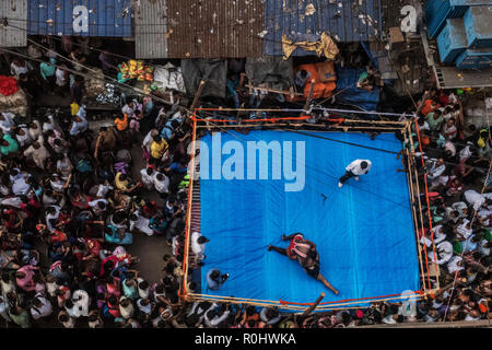 (181105) -- KOLKATA(INDIA), Nov. 5, 2018 (Xinhua) -- Wrestlers compete during a street competition to popularize the sport in Kolkata, India on Nov. 5, 2018. Wrestling once a royal national sport, in recent times, due to lack of sponsors, is facing hard times and its popularity is on the decline. (Xinhua Photo/Tumpa Mondal) - Stock Photo