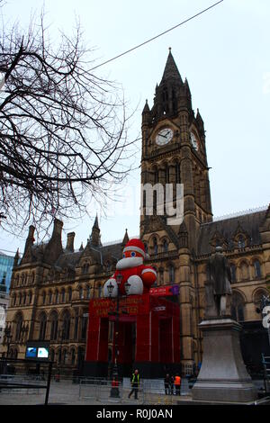 Manchester Town Hall with Merry Christmas Manchester & 'Zippy' Santa Claus - Stock Photo