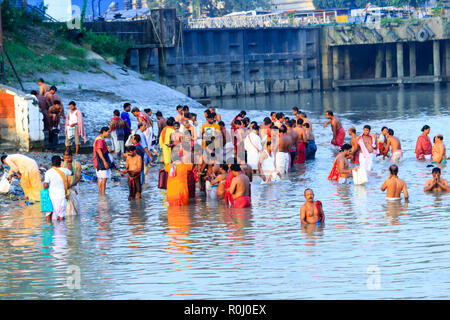 KOLKATA, INDIA - JANUARY 14, 2016: Devotees taking holy dip at Har Ki Pauri on river Ganga on the first bath of Ardh Kumbh fair. People took a dip in  - Stock Photo