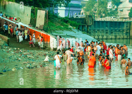 HARIDWAR, INDIA - JANUARY 14, 2016: Devotees taking holy dip at Har Ki Pauri on river Ganga on the first bath of Ardh Kumbh fair. People took a dip in - Stock Photo