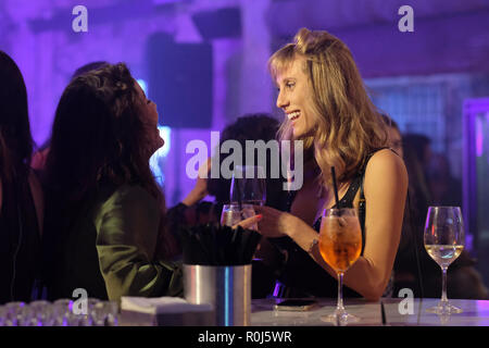 Young Israeli women chatting happily in a bar in Tel Aviv Israel - Stock Photo