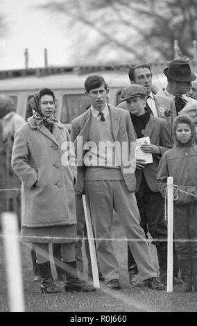 Queen Elizabeth II alongside his son, Prince Charles, at Badminton Horse Trials. - Stock Photo