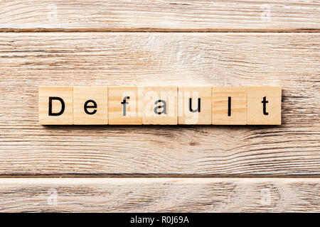 default word written on wood block. default text on table, concept. - Stock Photo