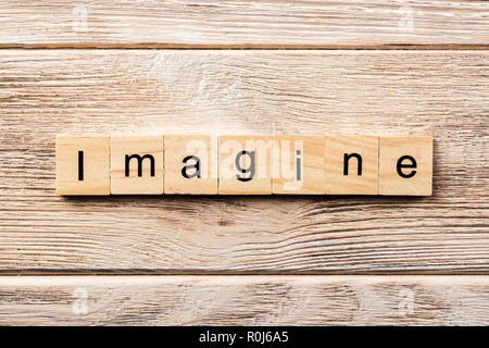 imagine word written on wood block. imagine text on table, concept. - Stock Photo