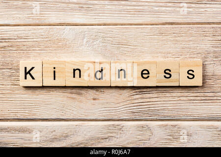 kindness word written on wood block. kindness text on table, concept. - Stock Photo