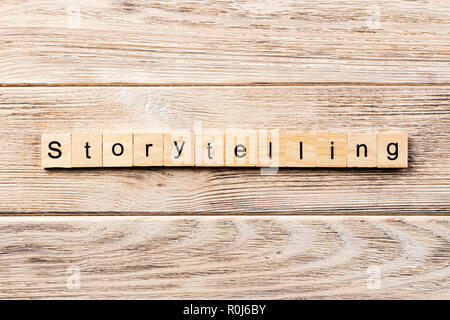 storytelling word written on wood block. storytelling text on table, concept. - Stock Photo
