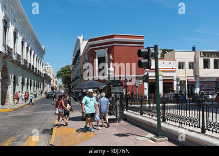 street with houses and shops in downtown merida, mexico. - Stock Photo