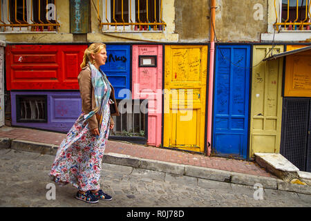 The girl in Istanbul. Colorful houses Balat district. - Stock Photo