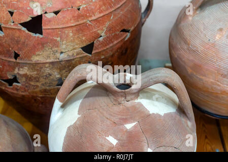 Ancient clay pots on display in museum - Stock Photo