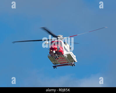 Inverness based Sikorsky S-92 HM Coastguard helicopter G MCGI departing to the Orkney Isles on a cll out mission. - Stock Photo