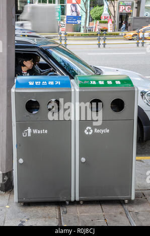 Rubbish bins on the pavement in Gangnam, Seoul, South Korea. There is  separate bin for rubbish which can be recycled to the bin for normal waste. - Stock Photo